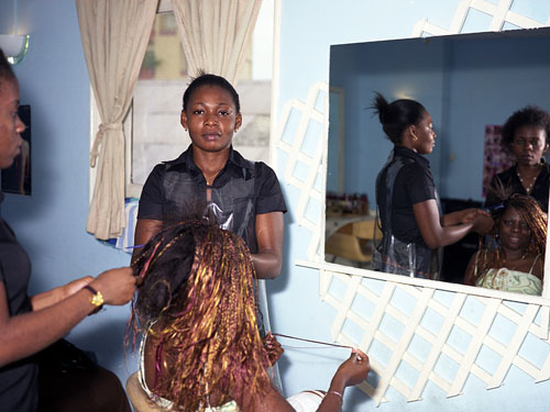 Marie Lucie Ayito and Sorelle Mayenne, Hairdresser and Esthetician, (Raymonde Ayigone, Client), Libreville, Gabon © Philippe Sibelly