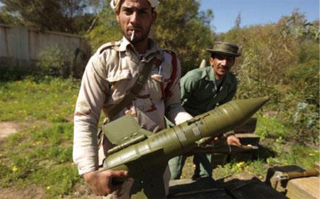 des combattants anti-Kadhafi. © Patrick Baz/AFP