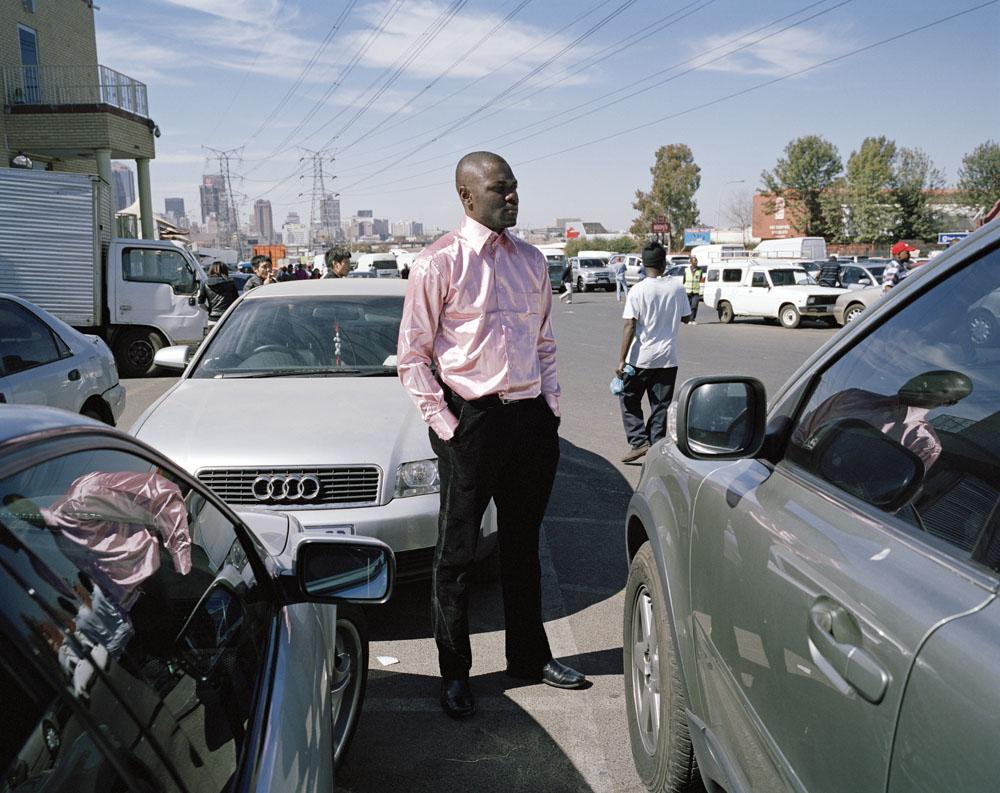 Pelou Mwepu-Kalonji, security guard, Dragon City, Main Reef Road, Johannebsurg, Gauteng, 2011. © Ilan Godfrey